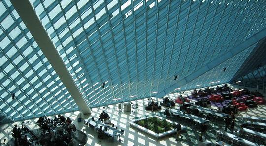 """""""Seattle Public Library on a sunny day"""" by Moody75 Licensed under a [CC BY-SA 2.0 (http://creativecommons.org/licenses/by-sa/2.0)], via Wikimedia Commons. Retrieved from http://www.flickr.com/photos/moody75/48112462/"""